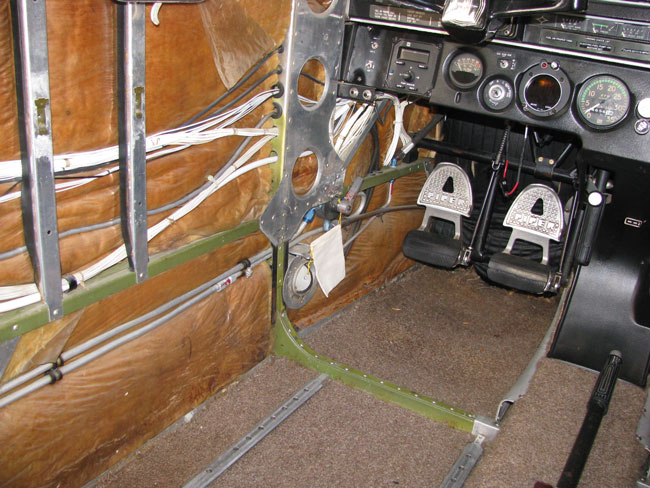 Left side of airplane interior with covering removed for annual inspection