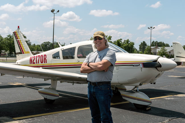 Owner and author Denny Kotz with airplane