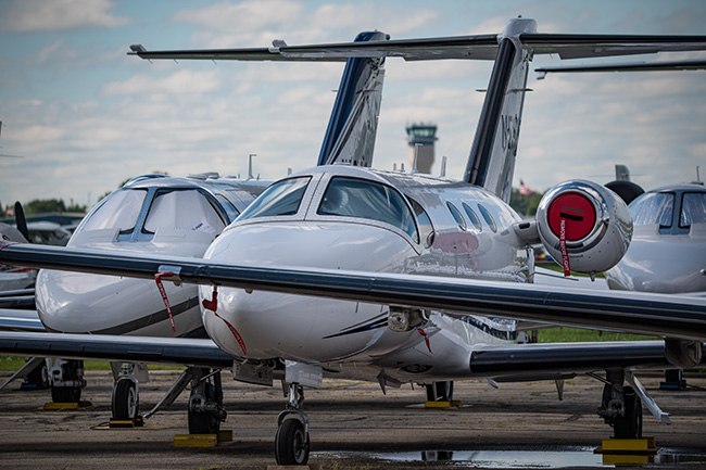 Corporate jets on the ramp.
