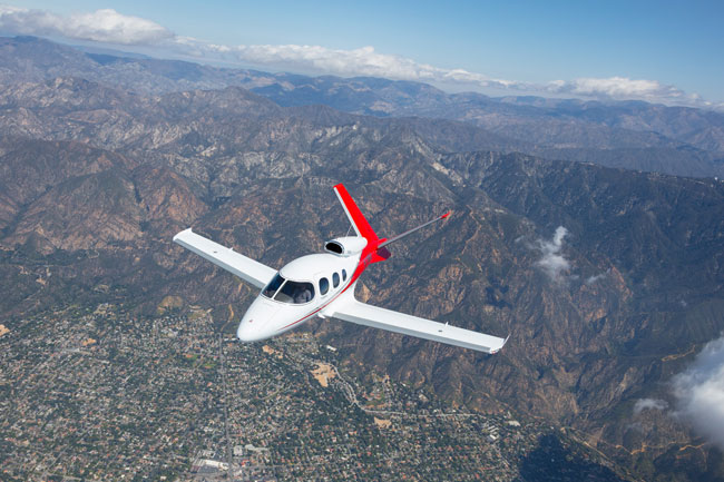 Cirrus SF50 Vision Jet over mountains