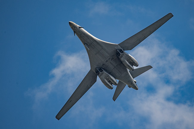 B-1 fly-by, wings extended.