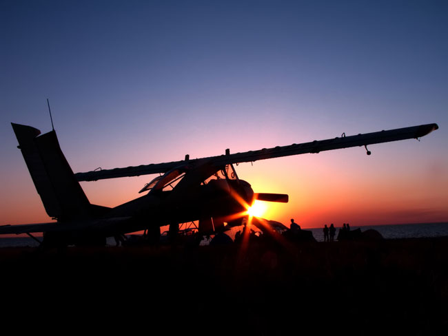 Time Flies: airplane at sunset