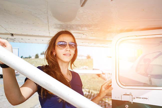 Woman by Plane