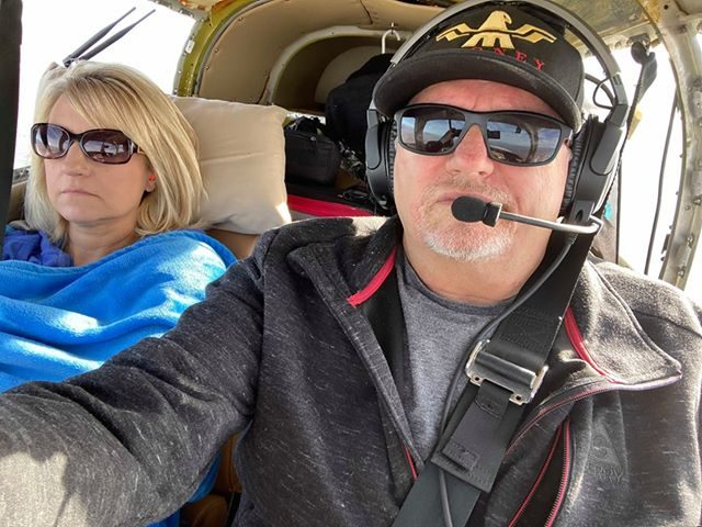Dennis Pruitt and his wife Karen flying.