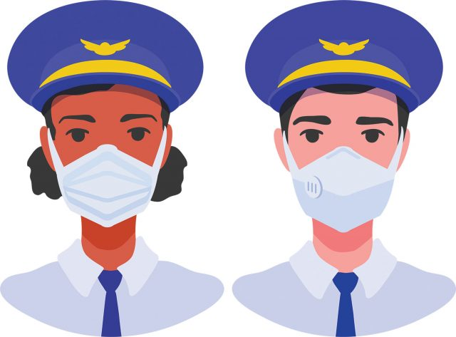 Pilots with medical masks on.