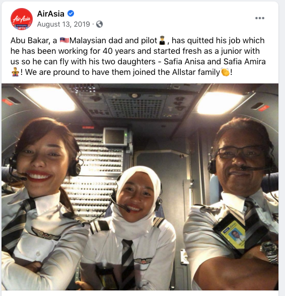 Abu Bakar flying with his daughters, Safia Anisa and Safia Amira, who are AirAsia first officers.