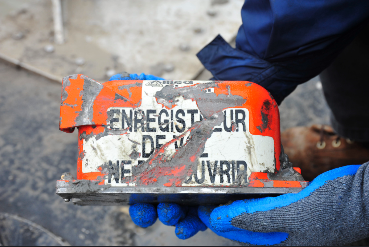 An investigator holds the flight data recorder of the Boeing 767-300 that crashed in February of 2019 while on approach to Houston's George Bush International Airport. Photo courtesy of NTSB.