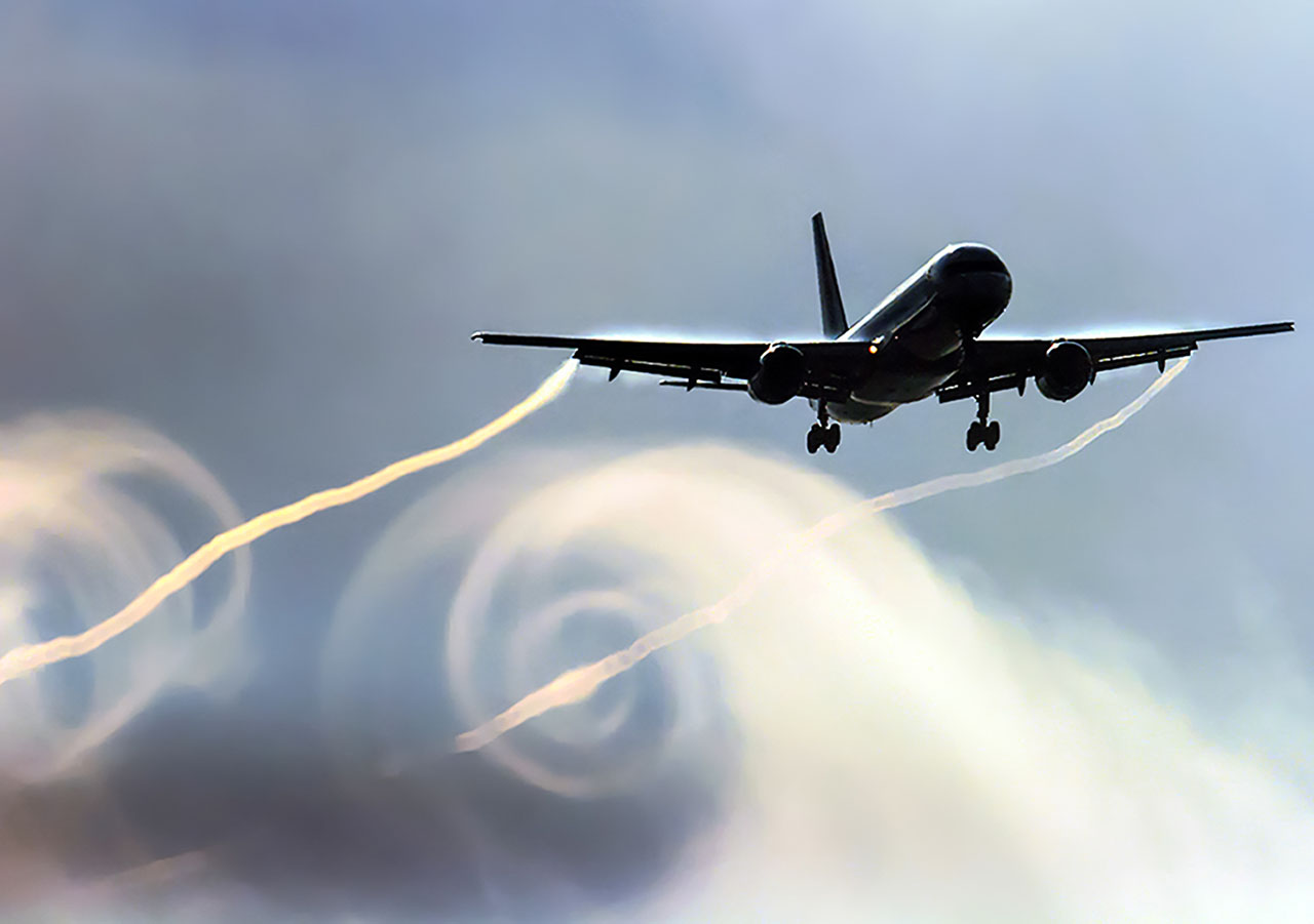 This photograph of a jet in landing configuration shows how at high angles of attack, the wing-tip vortices can be dramatic. While they're usually largely invisible, the danger isn't mitigated by that fact.