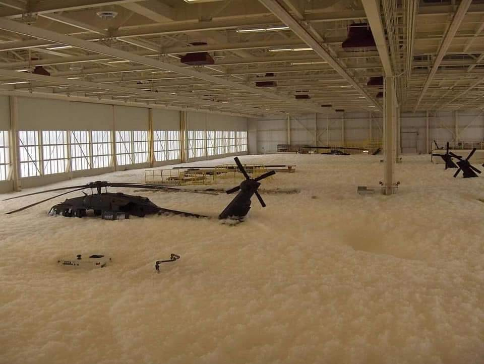 Blackhawk helicopters covered in fire retardant foam. Photo courtesy of Reddit
