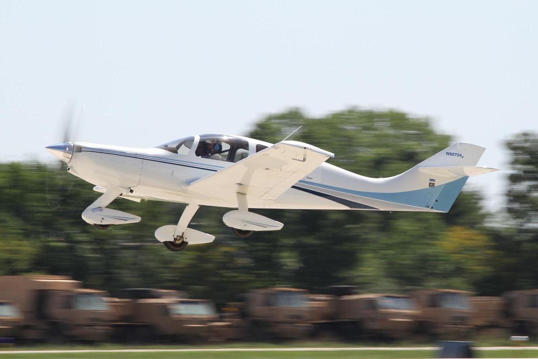 A Wheeler Express composite kit plane taking off at Oshkosh.
