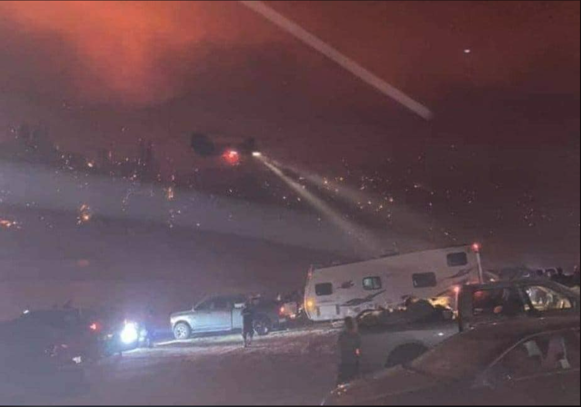 A screencap of the California National Guard rescuing people from a wildfire.