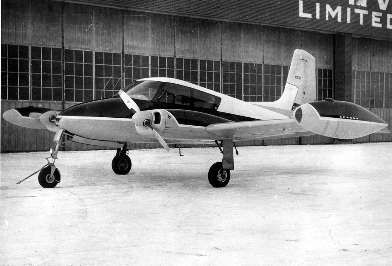 A vintage straight-tail Cessna 310 similar to N1812H.