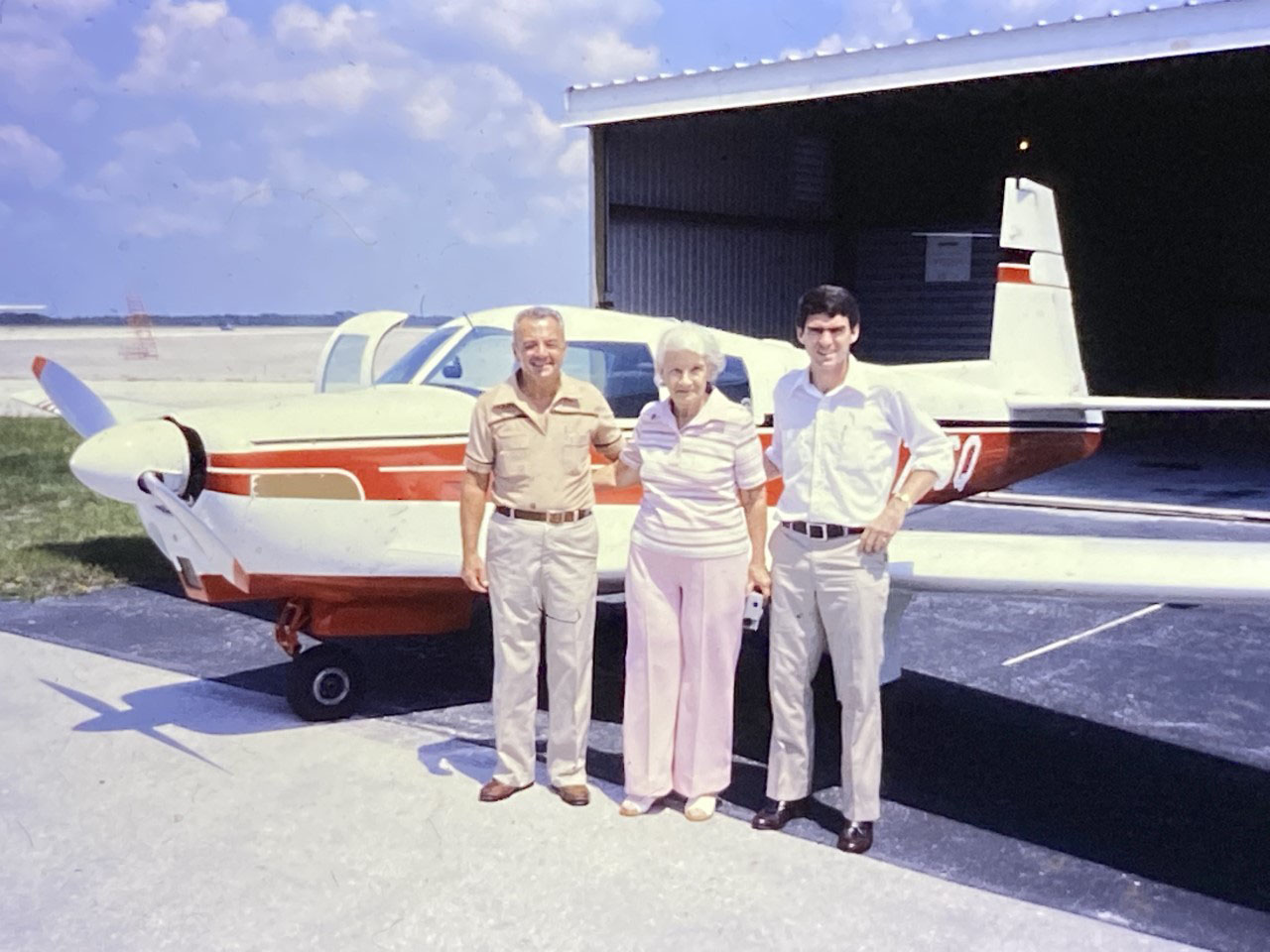Jeremy King's late friend Chris Smisson at right, with Roswell and Maude Mathis back in 1980 when they sold Smisson their beloved Mooney. The Mathises' son, Paul Mathis, saw a photo of his parents in our September 2019 issue and reached out to King.
