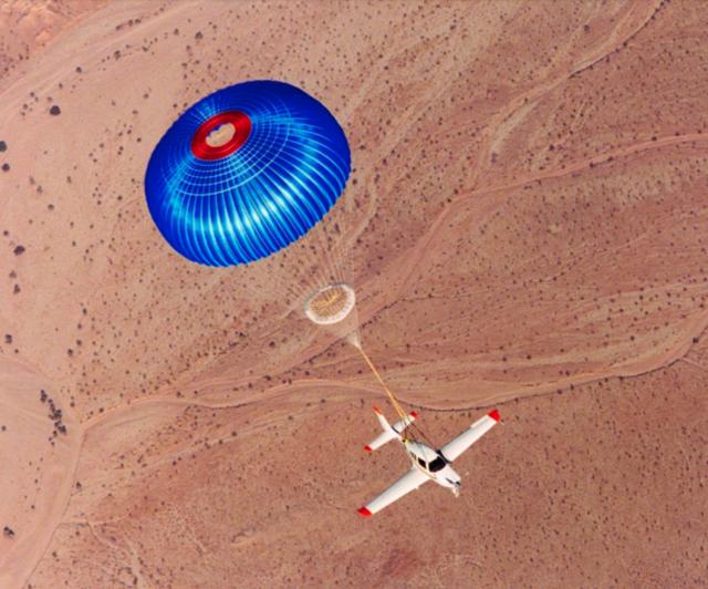 Photo of a Cirrus SR-series single under chute. Courtesy, Cirrus Aircraft.