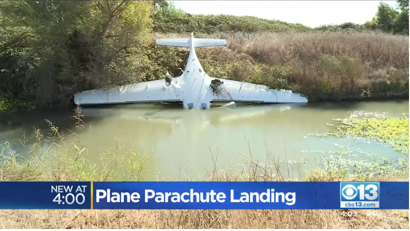 A screen capture from CBS Sacremento's coverage of a Cirrus that went down in California under its CAPS whole-airplane recovery parachute.