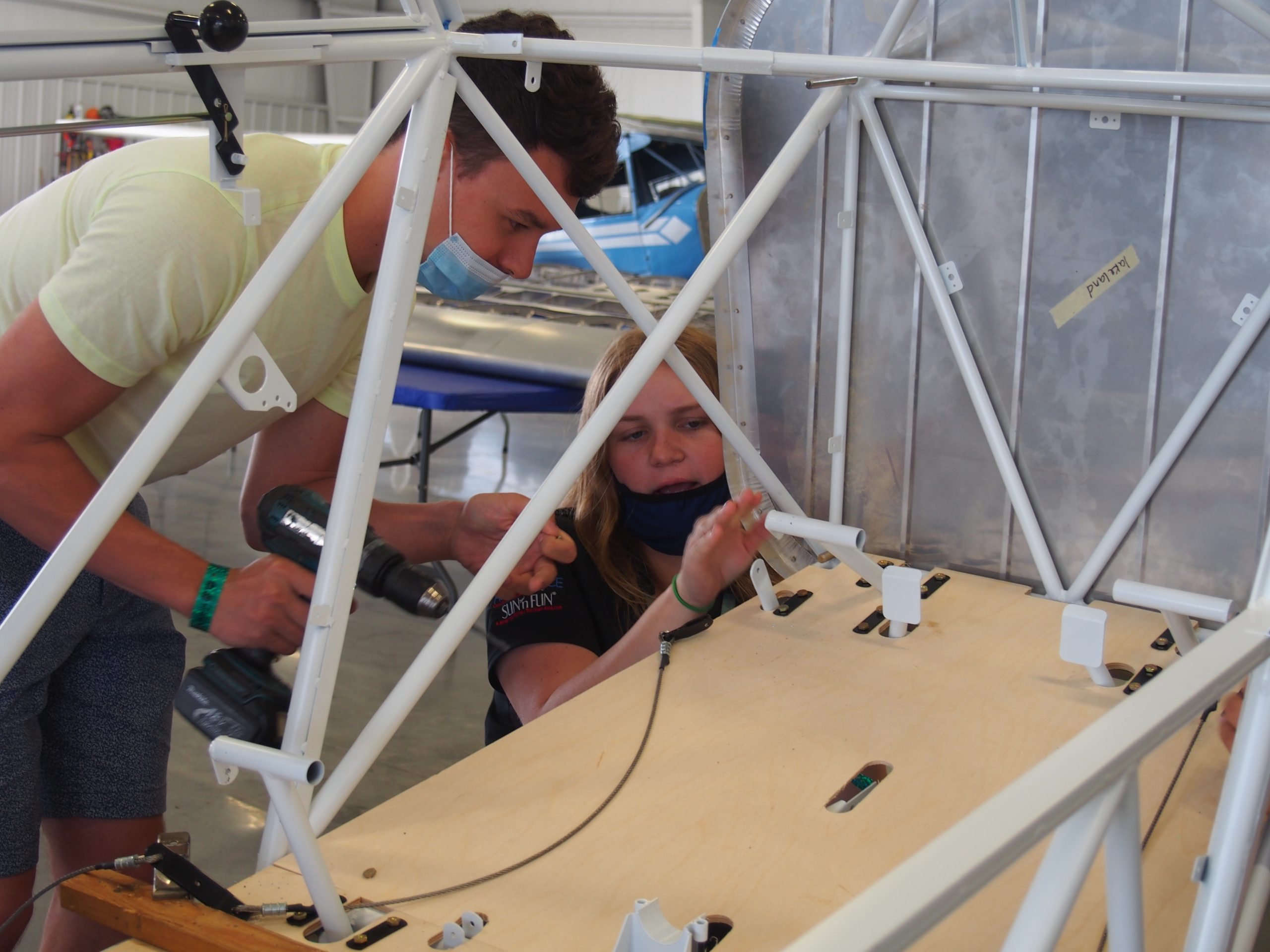 The members of the Lakeland Aero Club are assembling a Patriot Aircraft Recruit trainer at Sun 'n Fun 2021.