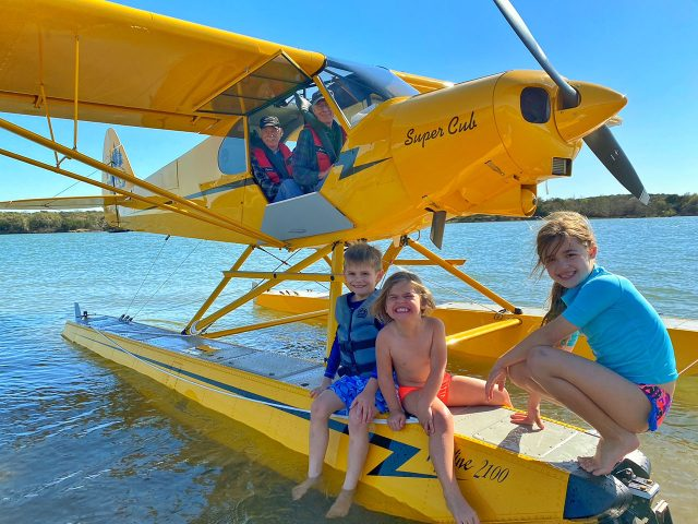 Tree kids ask Ken Wittekiend and Tim Casey to look at the Super Cub.